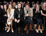 Douglas Booth and Sam Claflin sat front row at the London Fashion Week Mulberry Fall 2013 show in February while flanked by British beauties.