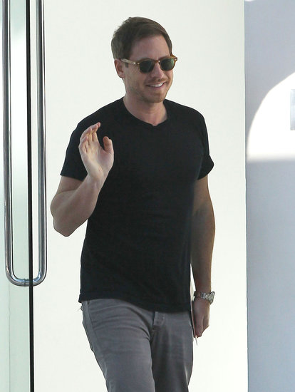 Drew Barrymore's husband, Will Kopelman, waved, leaving an LA art gallery.