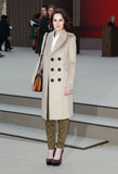 Michelle Dockery played around with neutrals in a beige double-breasted coat and olive cargos at Burberry Prorsum.