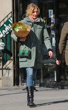Cameron Diaz sported an olive-green anorak with skinny jeans, black buckle boots, and a plaid Stella McCartney crossbody bag while toting flowers in NYC.