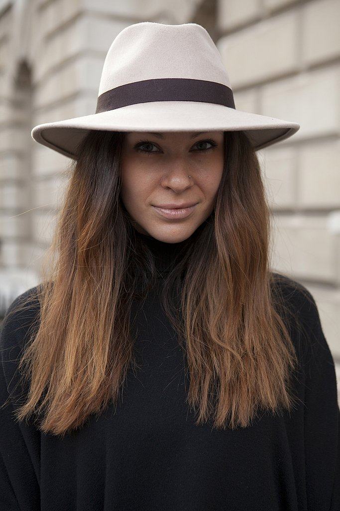 A sleek wool fedora contrasted against a dark color palette.