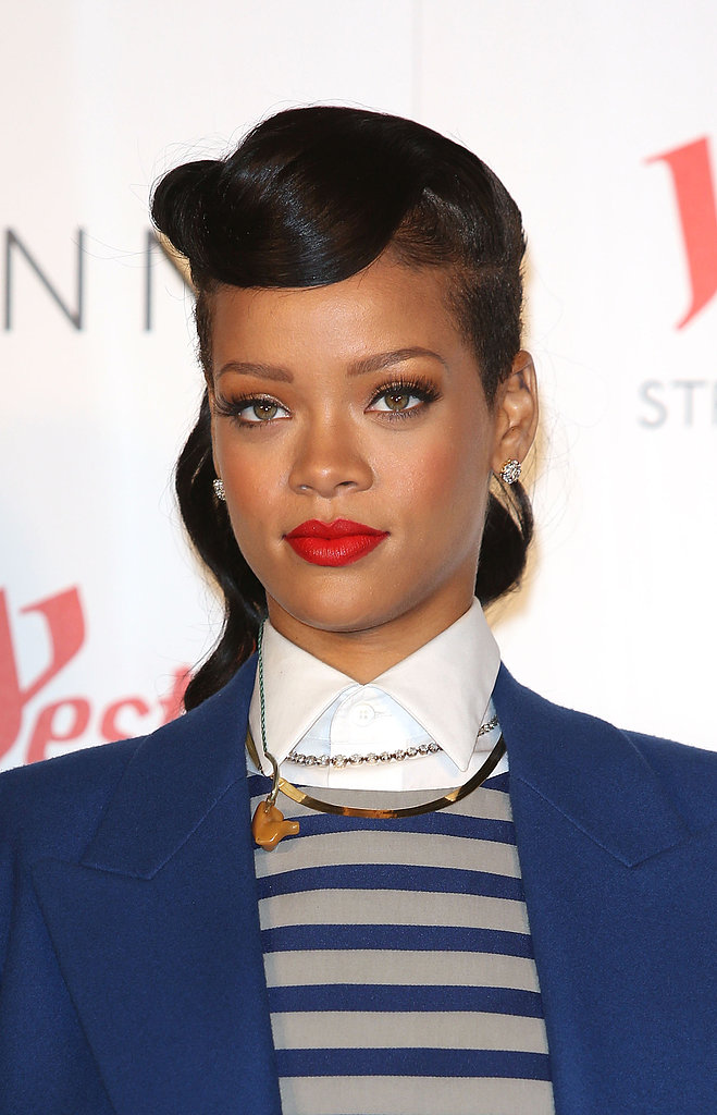 A few weeks later, while attending a Christmas-tree-lighting ceremony in London, Rihanna mixed things up yet again, wearing this retro updo.