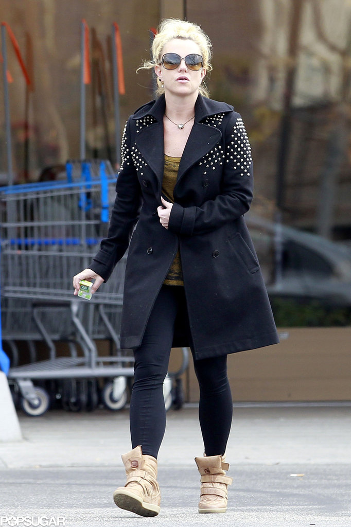 Britney Spears wore a black coat and wedge sneakers.