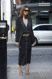 Vogue Australia's Christine Centenera paired a slick pencil skirt with easy knits and high-wattage shades and heels on her way to the shows.