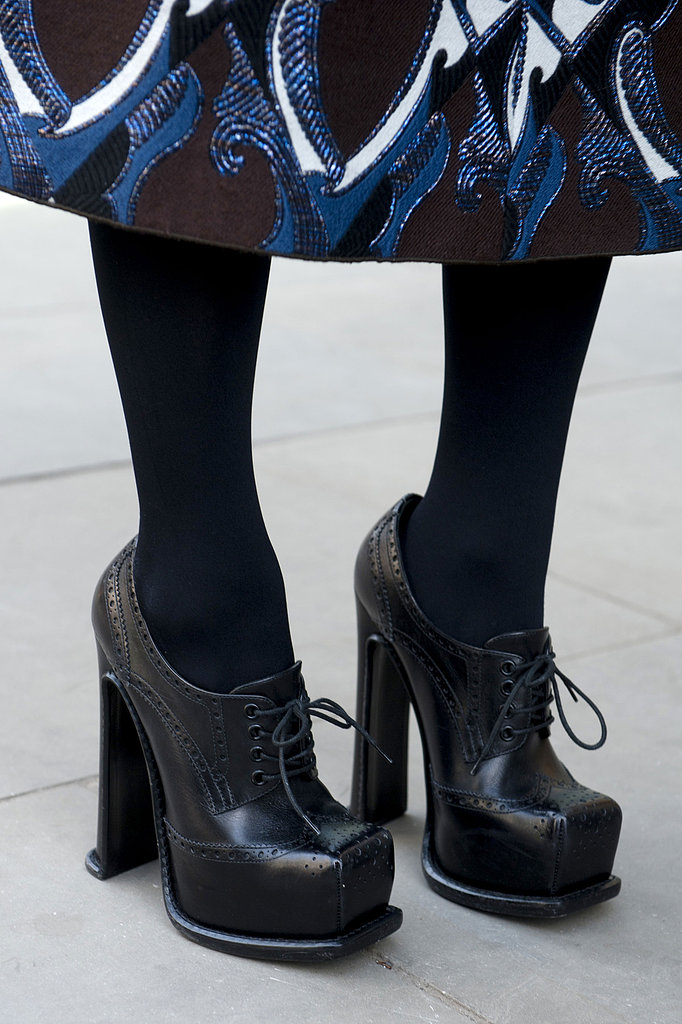 Stacked loafers added a schoolgirl charm to a printed skirt.