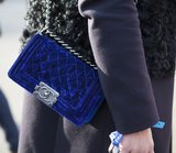 This blue velvet Chanel bag is the perfect statement piece.