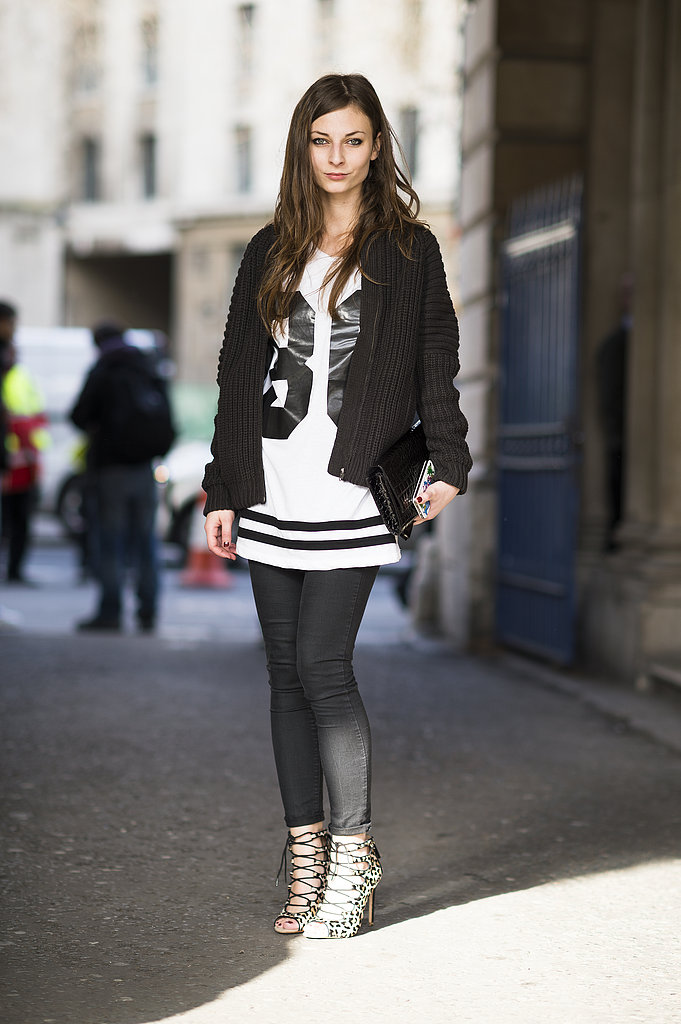 A sporty tee tempered the sexier side of her look, a pair of animal-print lace-up heels. Source: Le 21ème | Adam Katz Sinding