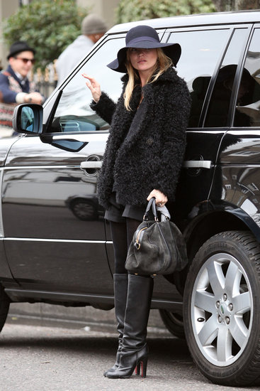 This look has all the makings of a signature Kate Moss style moment, thanks to the boho-rocker hat, fur, and all-black palette.