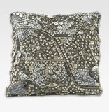 While you watch the show, cozy up to a sequined pillow ($150) that rivals any red-carpet dress.