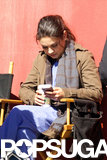 Mila Kunis took a coffee break and checked her phone while filming The Angriest Man in Brooklyn on Wednesday in LA.