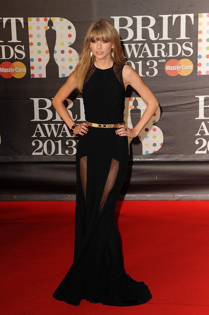 Taylor Swift wore a black Elie Saab gown with sheer paneling to the Brit Awards in London.