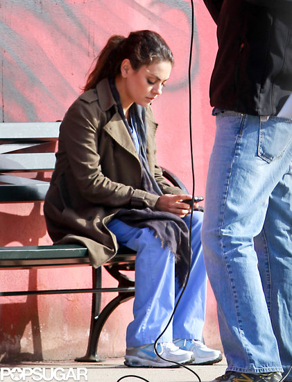 Mila Kunis checked her phone while filming in LA on Wednesday.