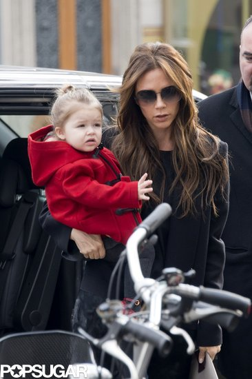 Victoria Beckham carried Harper Beckham in Paris.