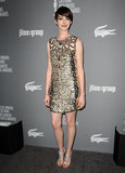 Anne Hathaway wore a gold dress.