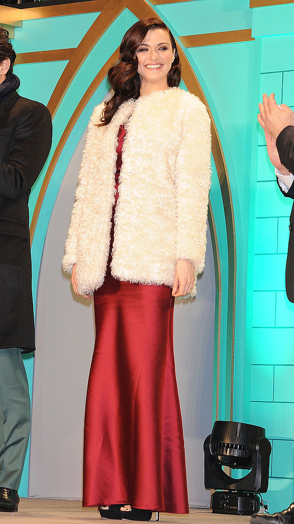 Before revealing her gorgeous dress, Rachel covered up in an ivory shearling coat.
