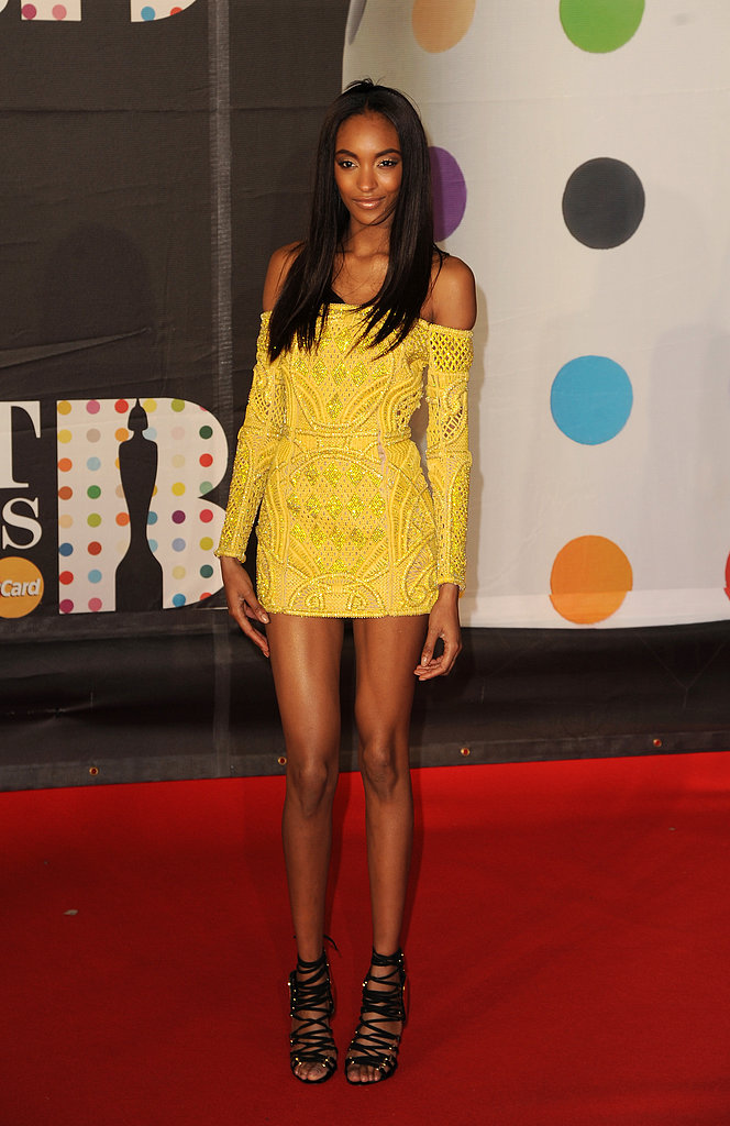 Jourdan Dunn delivered a pop of bright color in her yellow off-the-shoulder Balmain minidress.