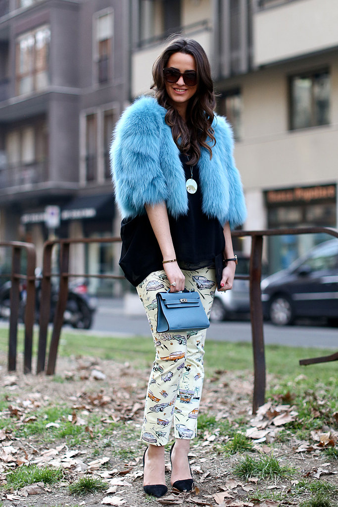 Another testament to the whimsy of Milan street chic with a furry blue chubby and printed pants.