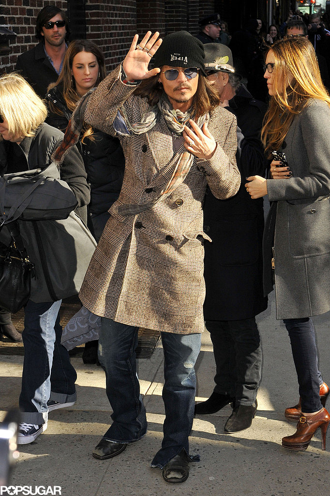 Johnny Depp gave a wave to the crowd in NYC.