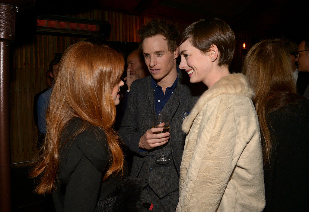 Anne Hathaway had a chat with Eddie Redmayne and Isla Fisher at a Vanity Fair-hosted Les Misérables pre-Oscars party in LA on Wednesday.