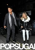 Josh Duhamel put his arm around Fergie on their way into a restaurant.