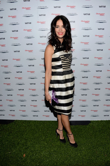 Abigail Spencer stepped out at Vanity Fair's celebration of Les Mis in a sharp black-and-white striped sheath, which she polished off with a glossy box clutch and a pair of ankle-strap heels.