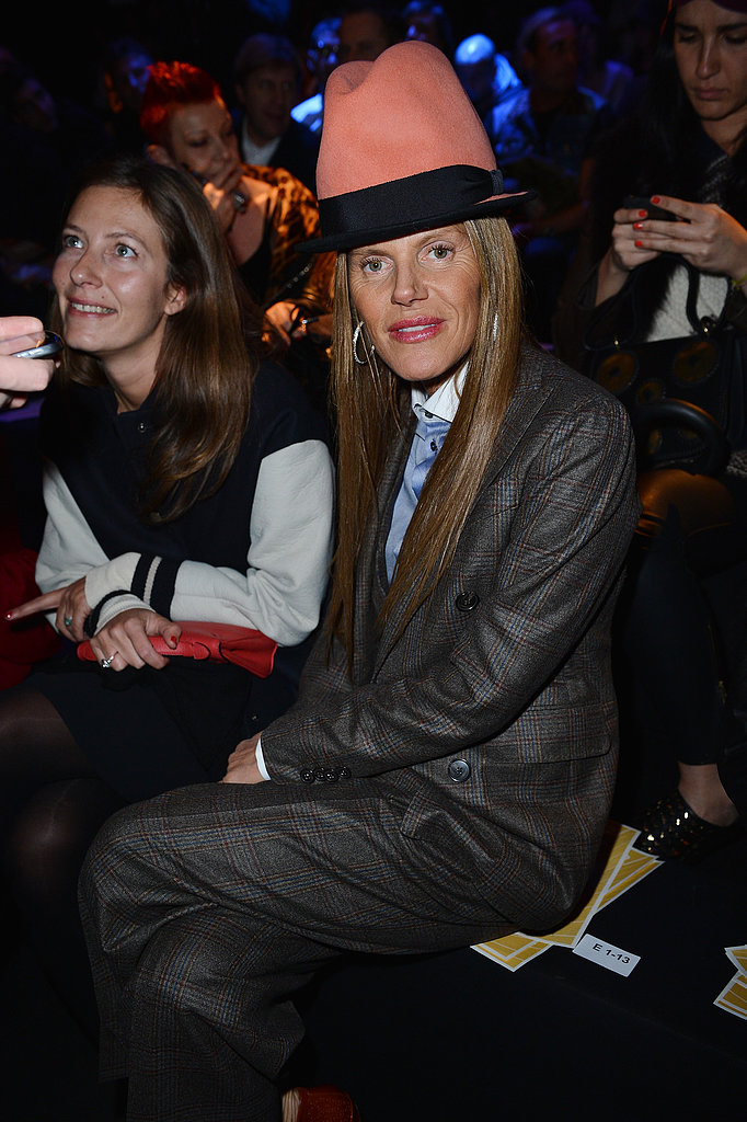 Anna Dello Russo showed off yet another hat, this time with a plaid pantsuit, at DSquared2.