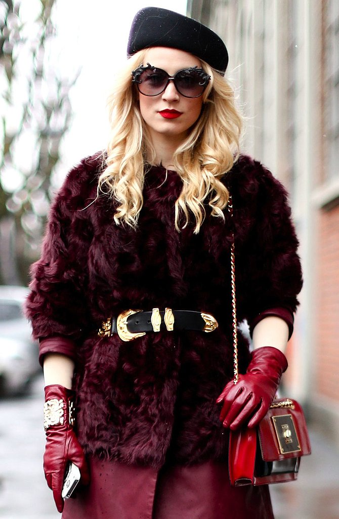 From the beret cap to the '70s shades and red gloves, this MFW attendee held nothing back in the accessories department.