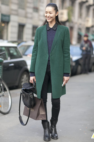 The texture on this emerald-green coat made it even more desirable — so did this showgoer's mix of a charming top and staple skinnies.