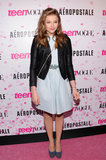 At her sweet 16 birthday in NYC, Chloë Moretz donned a baby-blue dress with a tough black leather jacket.