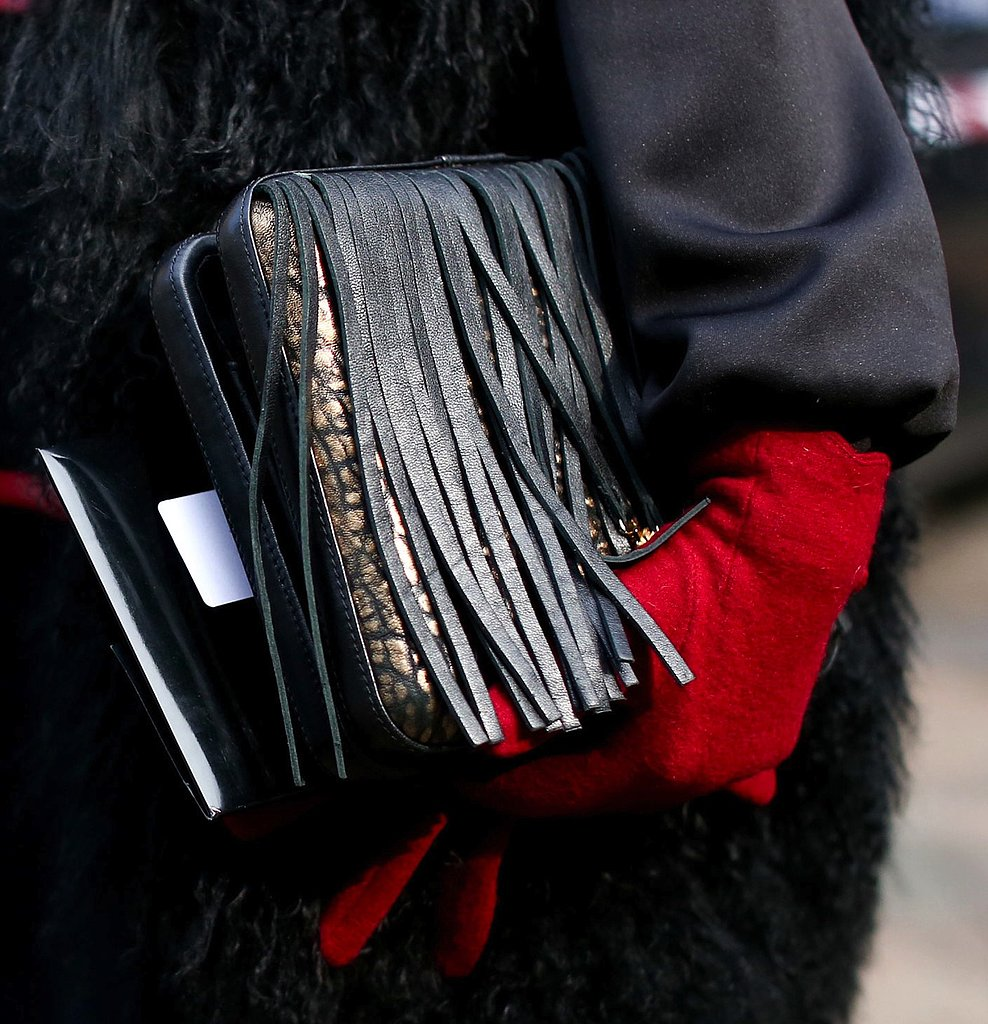 A fringed bag added an edgy element to this Fashion Week look.