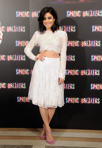 Vanessa Hudgens bared her midriff in a sweet lace Katharine Kidd ensemble at the Spring Breakers photocall in Madrid.