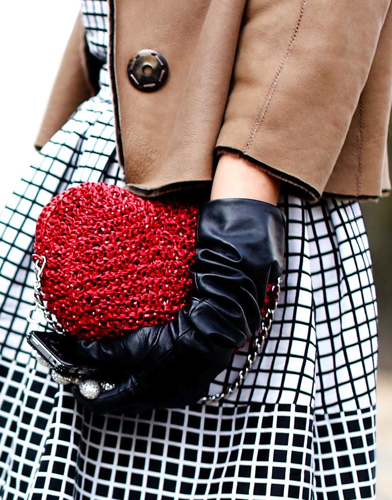 A whimsical red heart bag completed this graphic look.