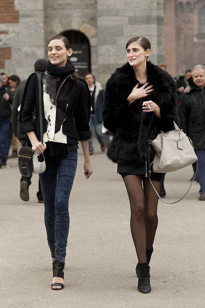 This leggy duo coordinated luxe satchels and furry black complements.