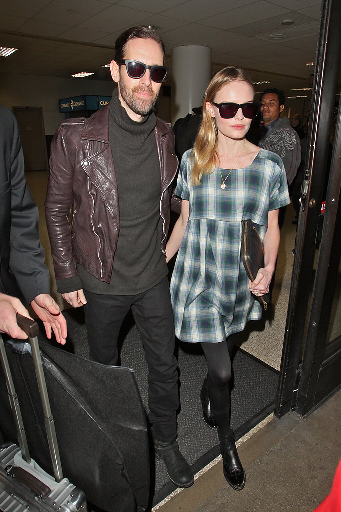 Kate Bosworth wore a plaid dress to travel to LAX with fiancé Michael Polish.