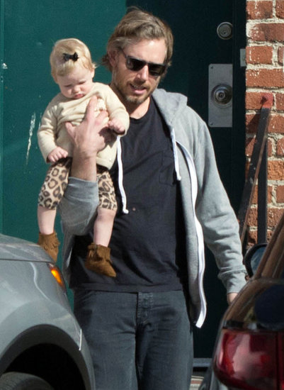 Eric Johnson carried baby Maxwell.