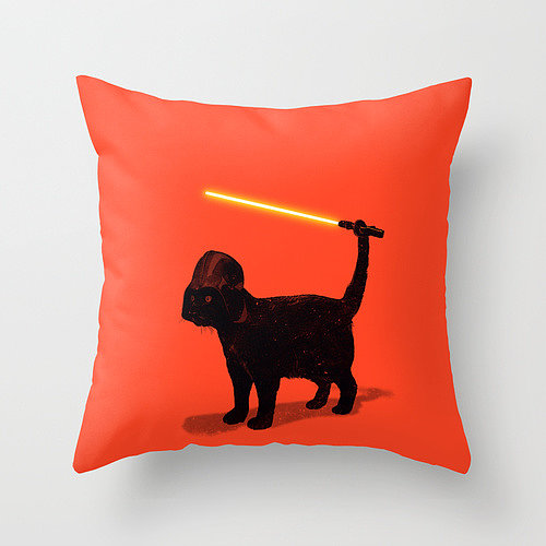 How terrifying would the world be if felines were actually equipped with lightsabers like Cat Vader, here on a pillow ($20).