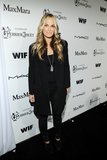 Molly Sims kept it casual in black leather pants and a black coat with studded shoulders at the Women in Film Pre-Oscar affair in LA.