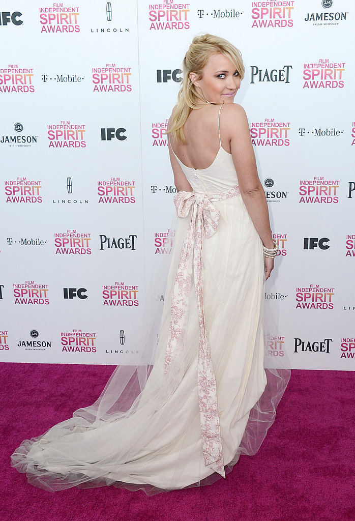 Emily Osment on the red carpet at the Spirit Awards 2013.
