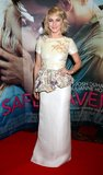 Julianne Hough mixed ladylike with daring in a Houghton floral beaded peplum dress and Stuart Weitzman shoes at the Safe Haven premiere in Dublin.
