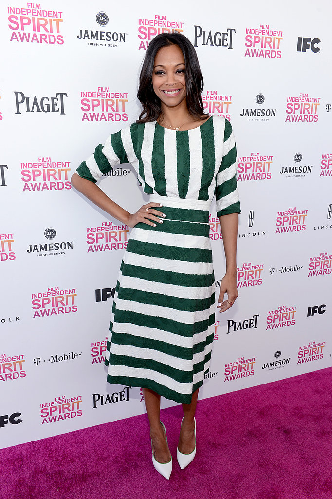 Zoe Saldana pulled off this loud, striped Dolce & Gabbana Spring '13 look with the utmost ease. She kept her hair down and undone and only added a stark pair of white Casadei pumps for the finish.