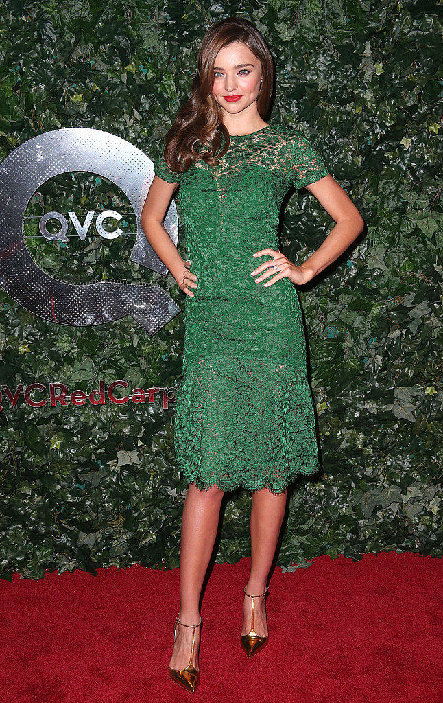 Miranda Kerr was fresh in a green lace dress and gold ankle-strap pumps at the QVC Pre-Oscar bash in LA.