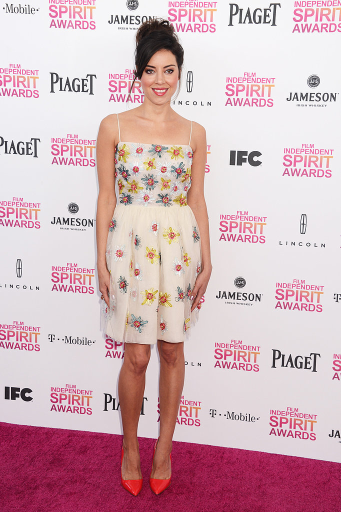 Aubrey Plaza went for playful and flirty in this floral-embellished slipdress and brightly hued pointy-toe pumps.