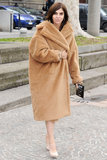 Carine Roitfeld stayed cozy and chic in a camel-colored shearling coat on her way into Roberto Cavalli's show at MFW.