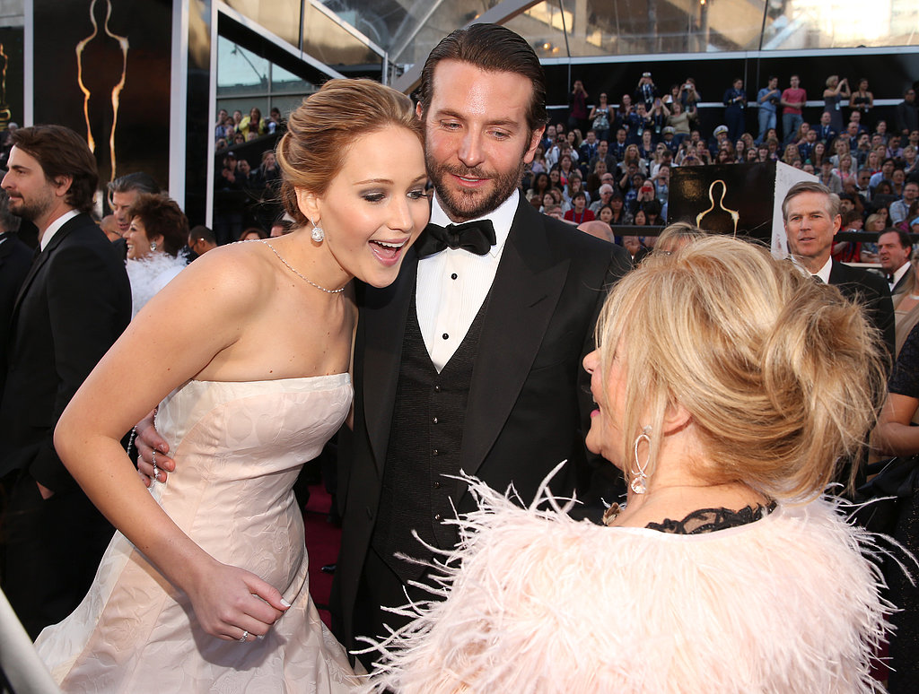 Jennifer Lawrence shared a moment with Bradley Cooper and his mom on the red carpet at the Oscars 2013.
