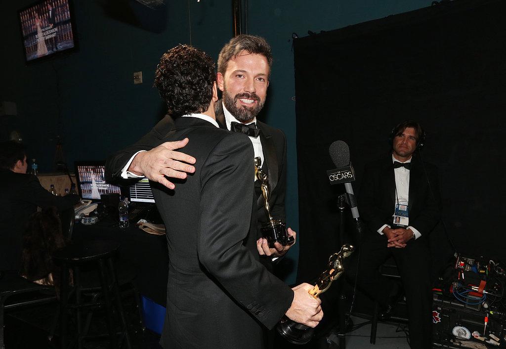 Ben Affleck got a hug from Grant Heslov backstage at the Oscars.