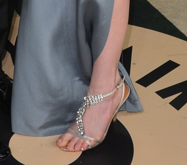 Anne Hathaway changed into a blue silk Saint Laurent dress and crystal-embellished sandals at the Vanity Fair bash.