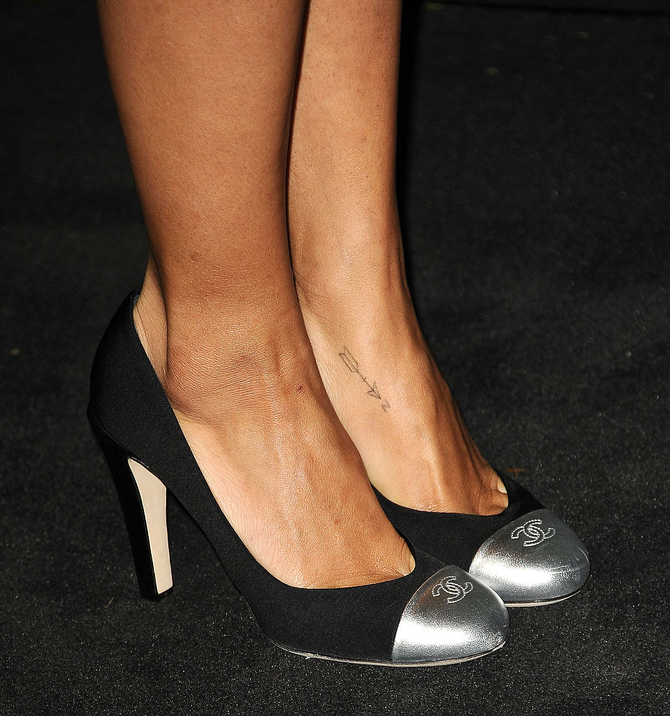 Zoe Kravitz wore Chanel cap-toe pumps with her sheer black Chanel minidress at the Chanel dinner.