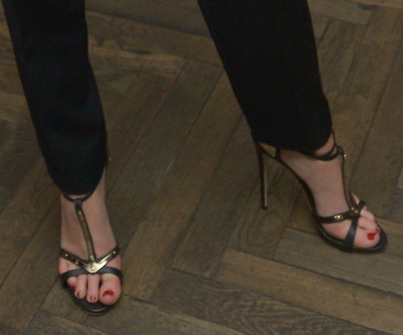 Jennifer Lawrence completed her tuxedo-inspired getup via black-and-gold T-strap sandals at the Weinstein
