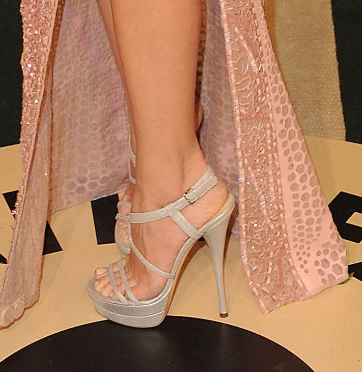 Olivia Munn's sexy Atelier Versace dress found the perfect companion in her metallic platform Versace sandals.