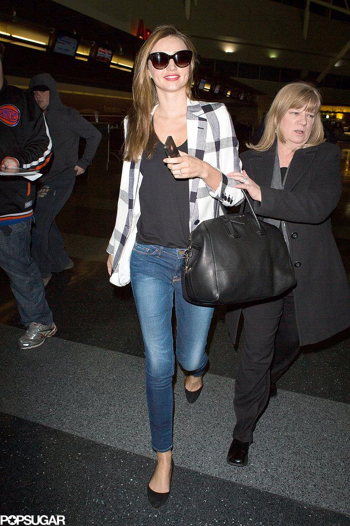 Miranda Kerr carried a black bag.